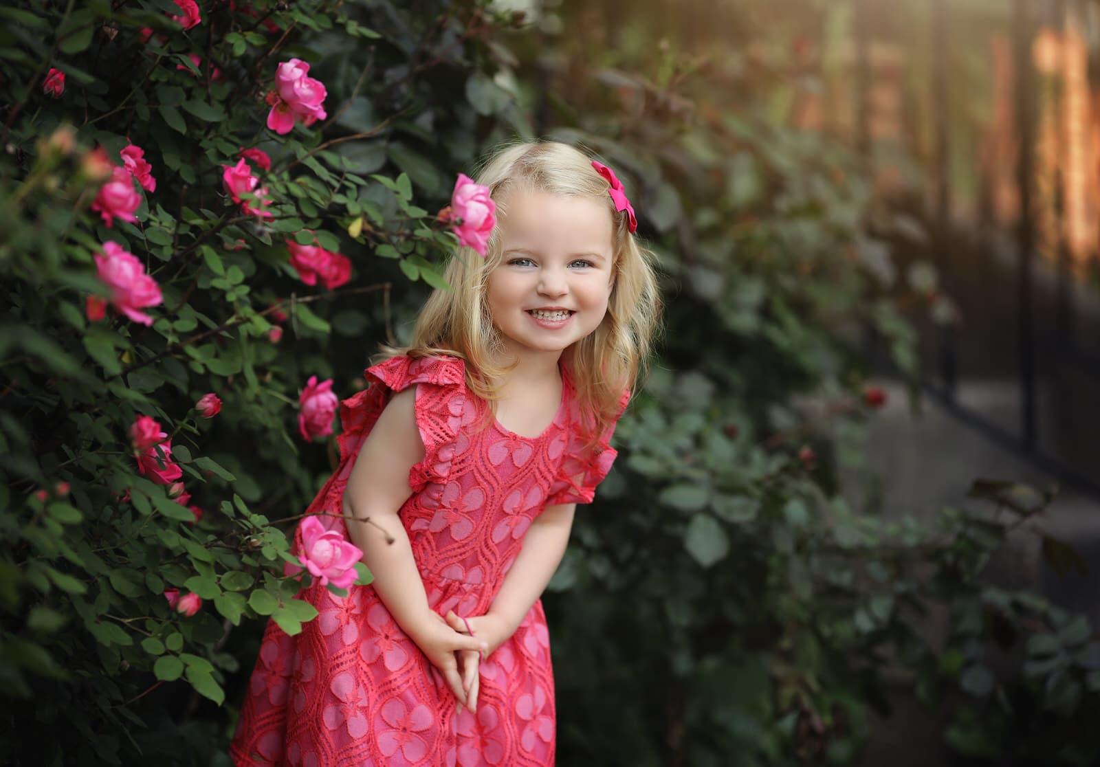 Harrisburg baby photographer little girl smiles happily during photoshoot near Mechanicsburg PA