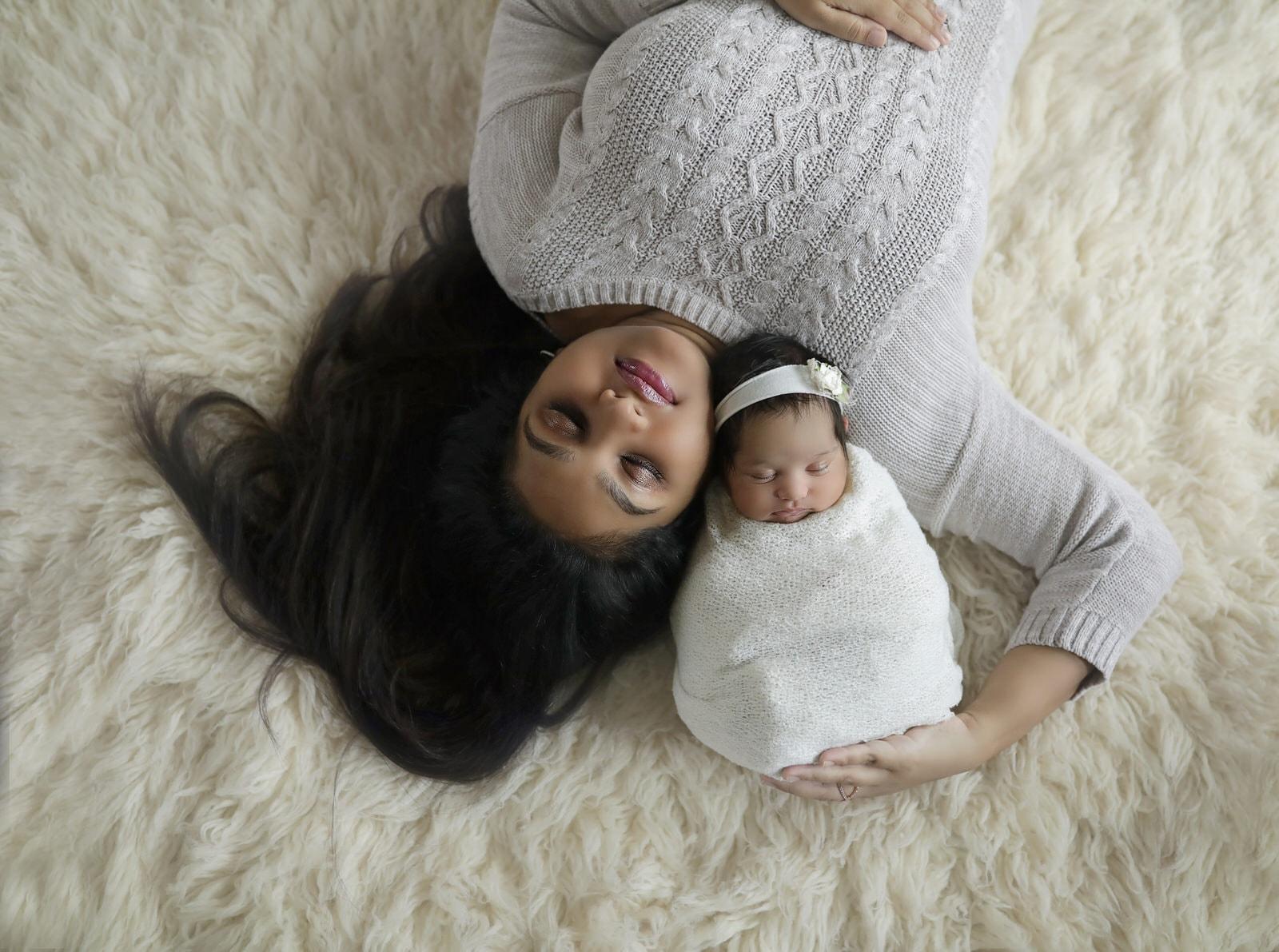harrisburg newborn photographer captures mom with newborn daughter on white background