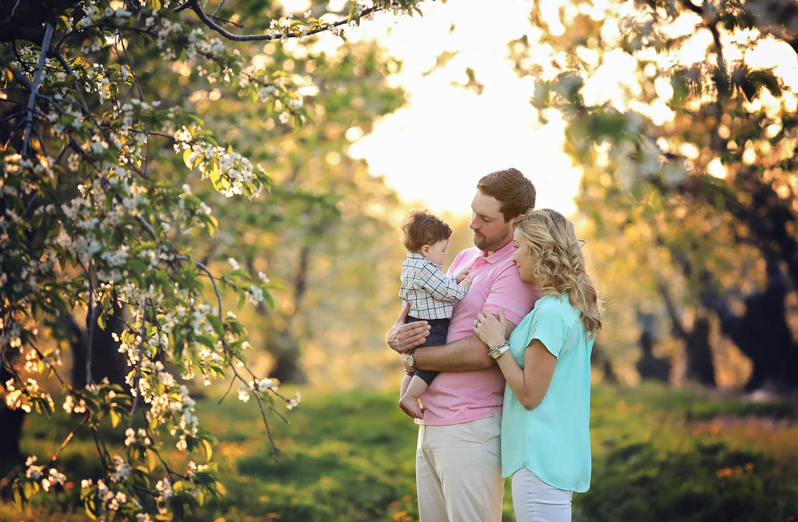 parents pose with baby boy during spring photoshoot in harrisburg pa