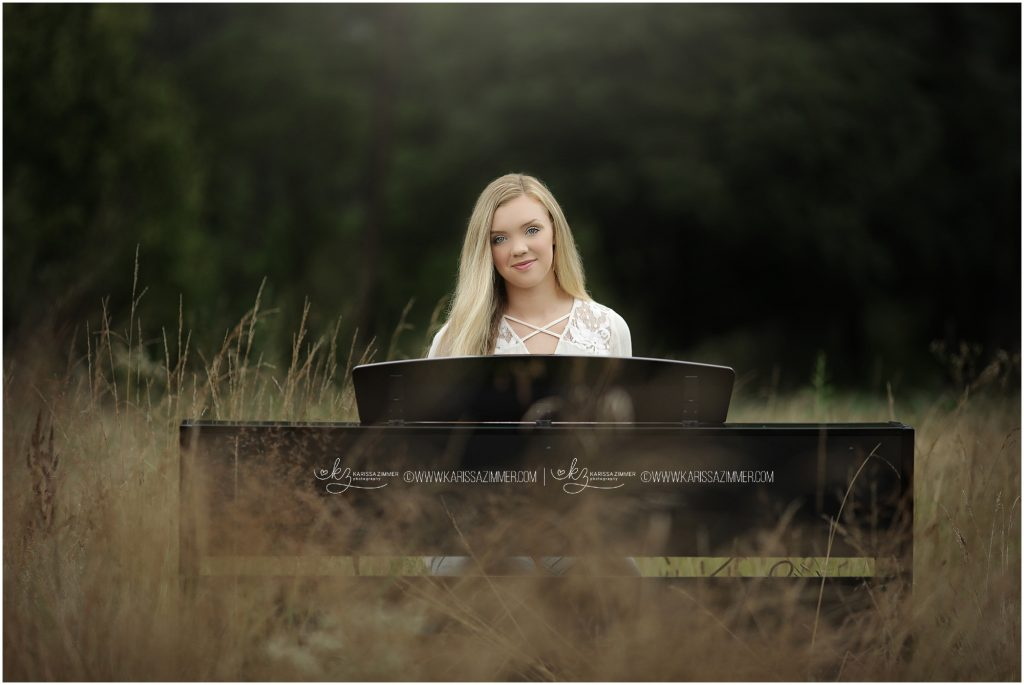 high school girl plays the piano in her harrisburg pa senior photos