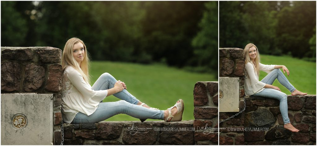 senior pictures of girl on stone wall near harrisburg