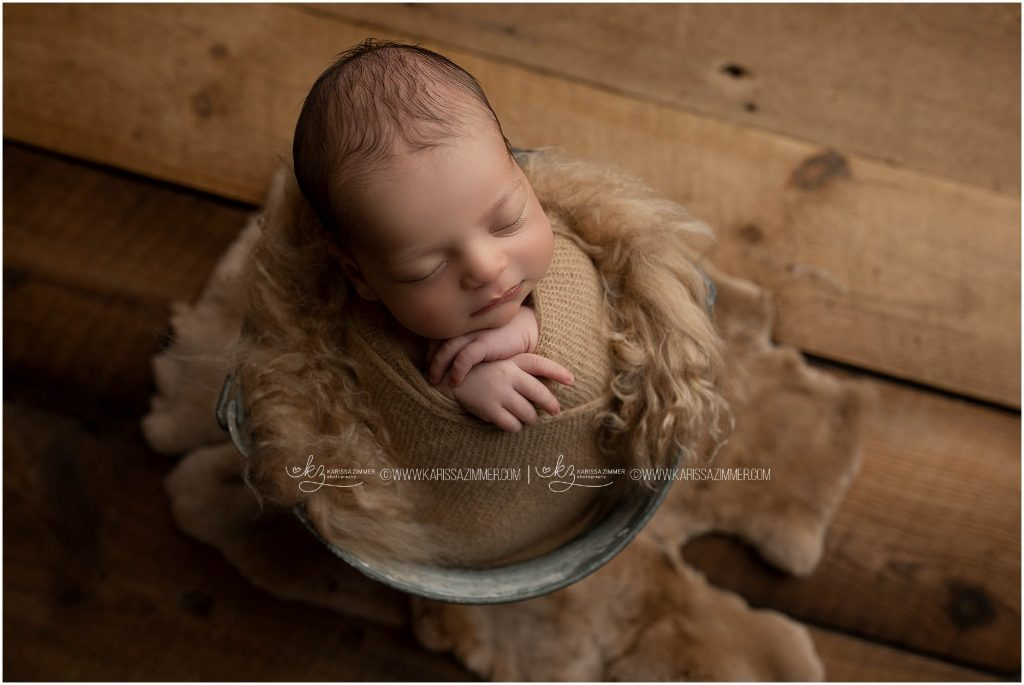 karissa zimmer photography captures images of posed newborn baby