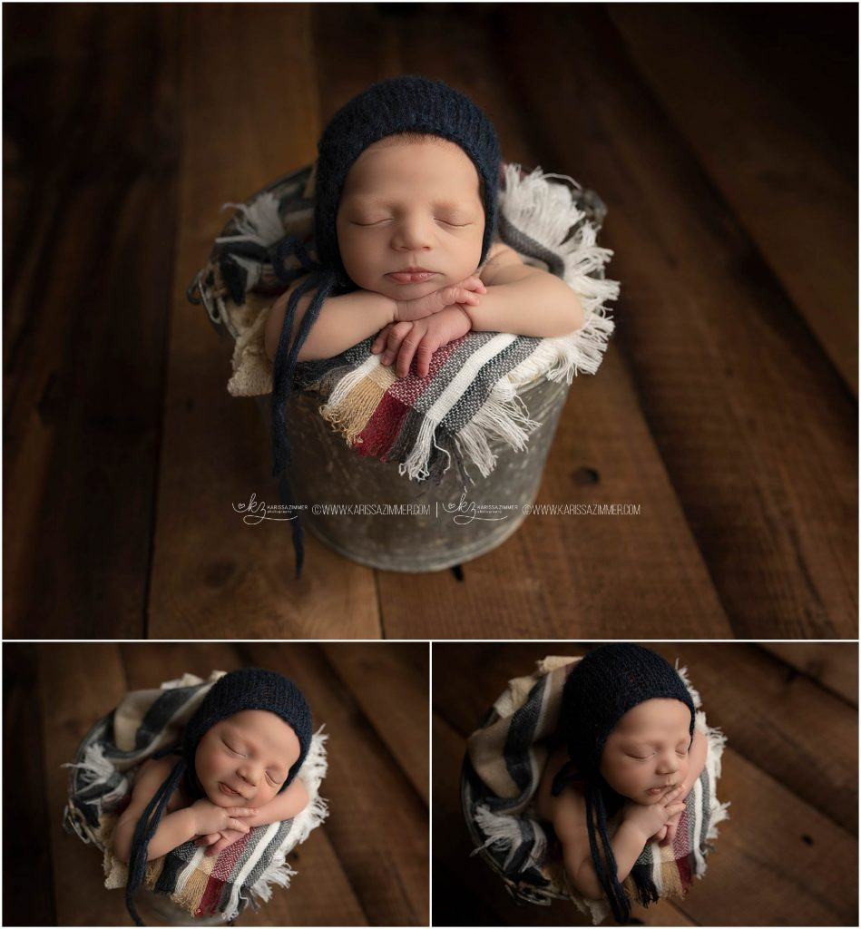 baby boy posed in bucket and photographed by mechanicsburg pa best newborn photographer
