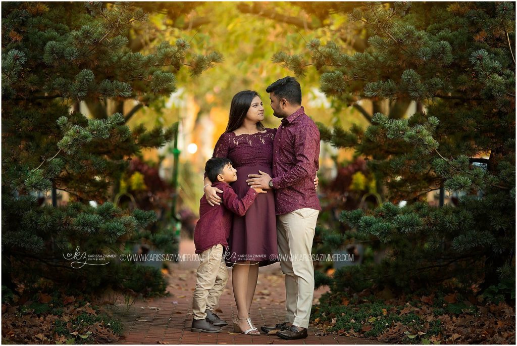 family poses together during their camp hill maternity photography session with karissa zimmer phtography