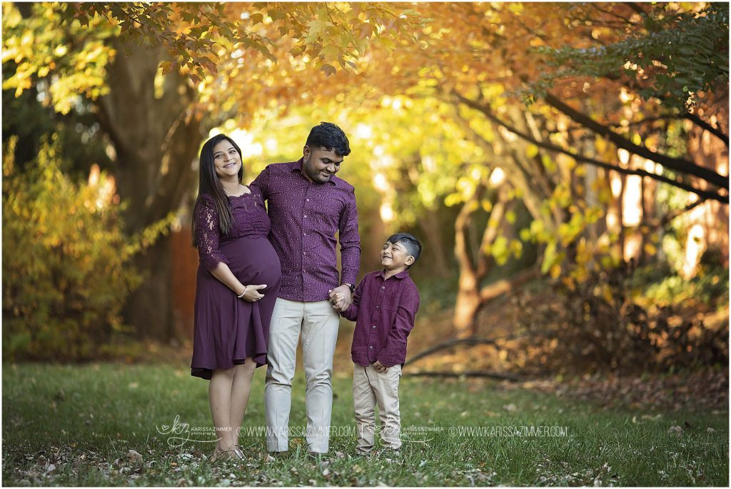 parents pose with their little boy during maternity session with karissa zimmer photography