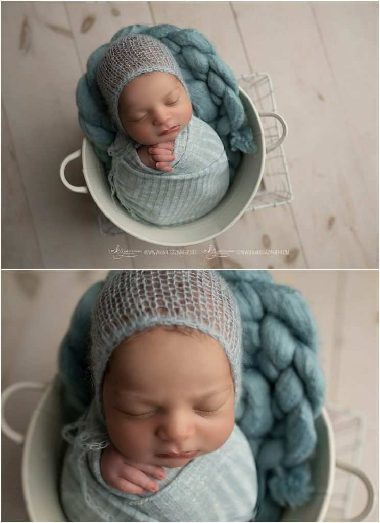 newborn photography session in camp hill pa shows baby boy posed in blue and white bucked