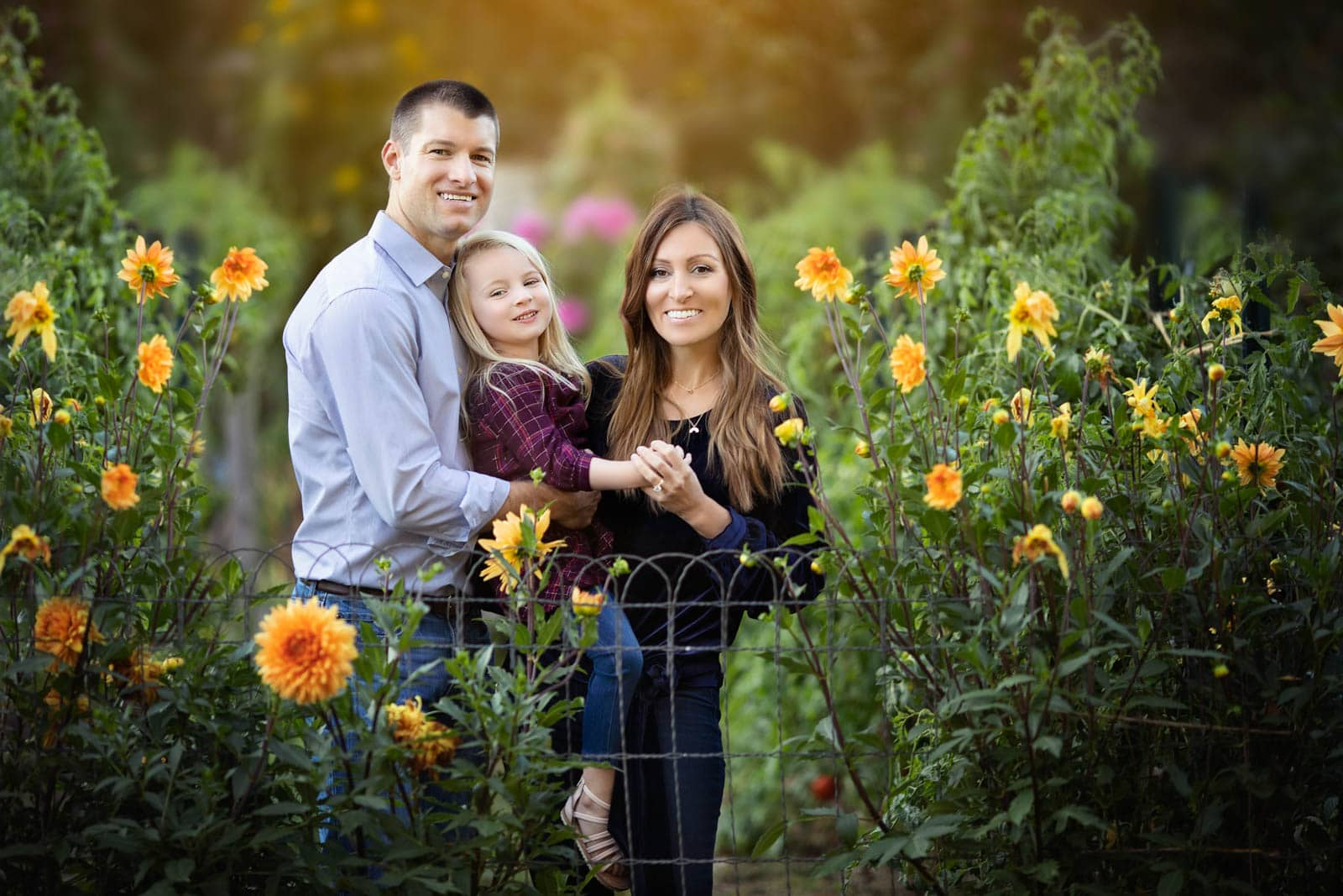 family photographed in colorful flowers near Harrisburg PA by Karissa Zimmer Photography