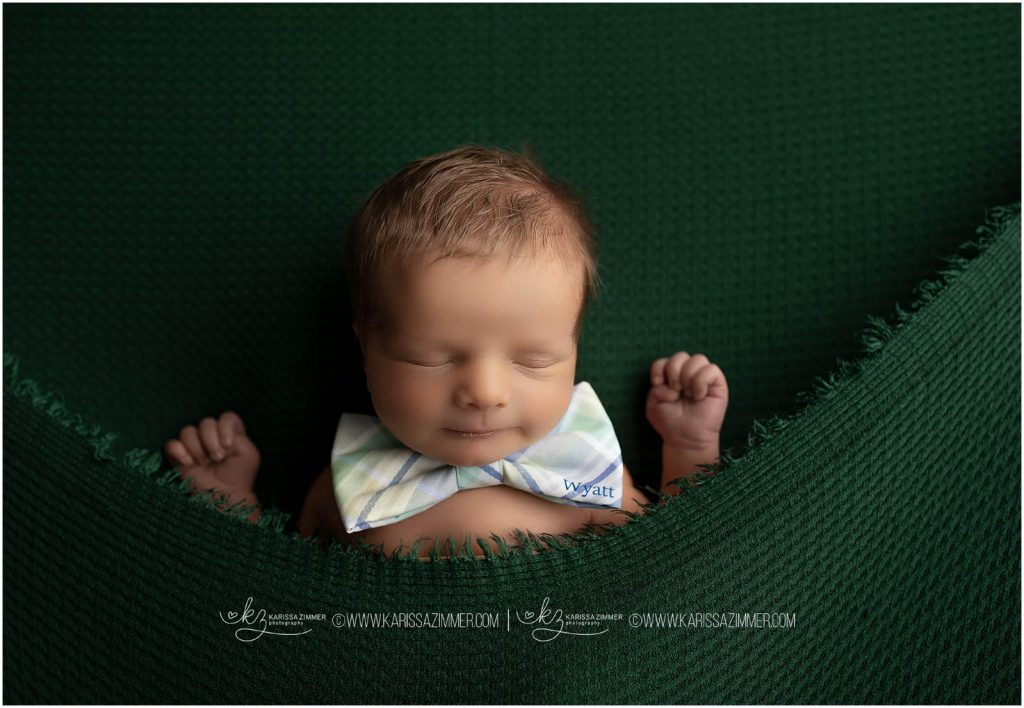 baby boy with name bow tie photographed at camp hill photography studio during his newborn session