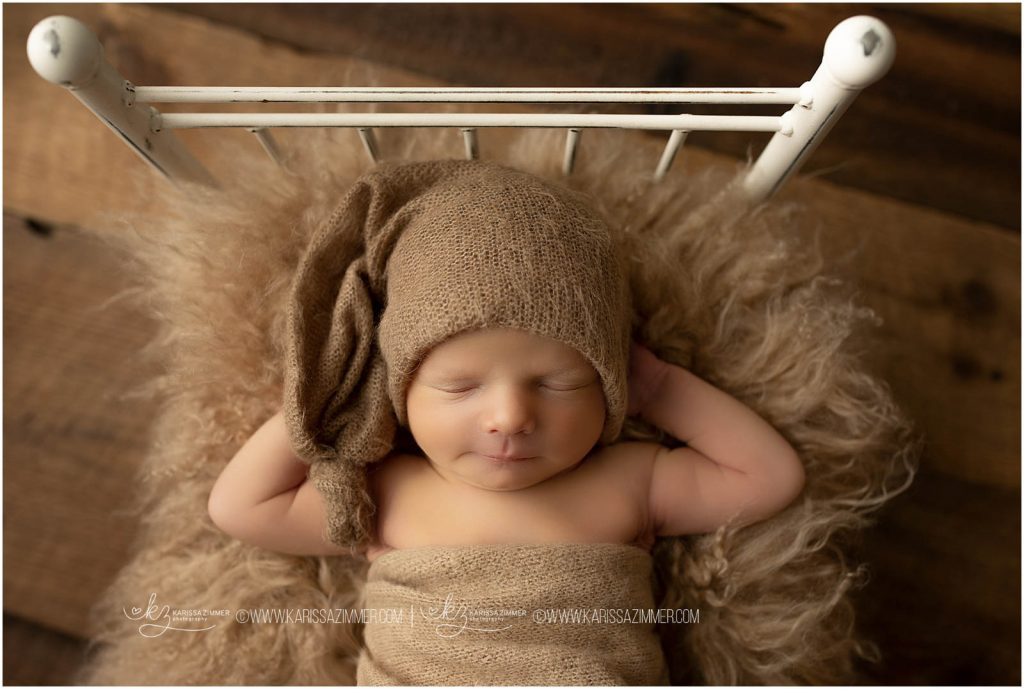newborn baby boy photographed on bed prop at camp hill newborn photography studio
