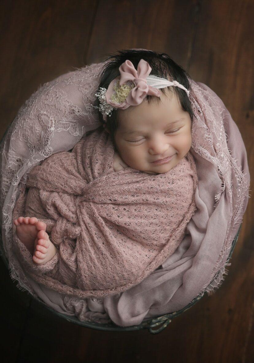 Newborn girl photographed by newborn and family photographer near mechanicsburg pa