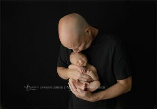 Why are photos of your newborn baby so important? THIS. This right here is a moment that will never happen again just like this. Your baby is only tiny enough to fit so perfectly in his dad's hands for a few short days. Trust me, you don't want to miss this.   #camphillnewbornphotographer #harrisburgnewbornphotographer #mechanicsburgnewbornphotographer #mechanicsburgphotographer #newbornphotographernearme #customnewbornphotography